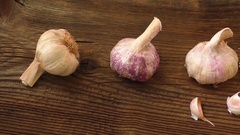 Garlic bulbs on wooden board, natural medicine, eat healthy food Stock Footage