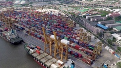 Aerial footage of cargo ships and containers at seaport Stock Footage