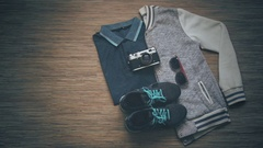 Hand puts the phone. Sport clothes and gadgets, top view Stock Footage