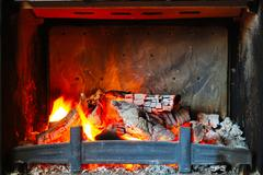 Burning wood in the fireplace Stock Photos