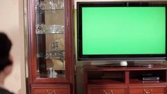 Woman watching TV. Chroma key Stock Footage