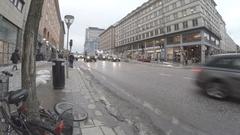 Traffic on sveavägen in central Stockholm after snow melt Stock Footage
