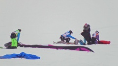 Kazan, Russia, 7 january 2017, Snow-kite festival orange wind, athletes prepare Stock Footage