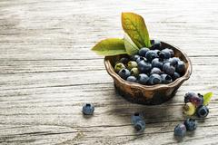 Blueberries on wooden table Stock Photos