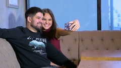 Laughing happy couple in cafe, making selfie Stock Footage