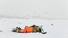 Kazan, Russia, 7 january 2017, Snow-kite festival orange wind, athletes ready Stock Footage
