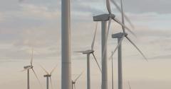 Wind turbine farm producing clean energy Stock Footage