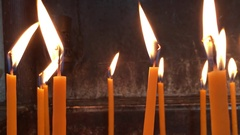 Flame of Burning Wax Candles Waving in the Wind Stock Footage