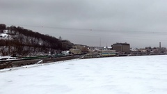 Traffic on Naberezhne Highway with Podol and frozen Dnipro river Stock Footage