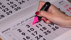 Female hand undercore 4 calendar day with pink marker and write free day Stock Footage