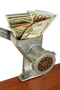 Money concept with dollar banknotes in meat grinder taken closeup. Stock Photos