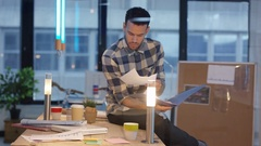 4K Businessman working on his own in casual creative office Stock Footage