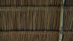 Asian traditional grass straw roof construction design from inside Stock Footage