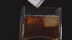 Ice Melts in Drink Stock Footage