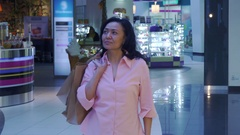 Woman shows her thumb up at the mall Stock Footage