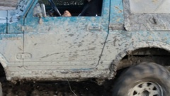 4x4 offroad vehicle is trying to cross the muddy area Stock Footage