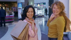 Women turn back at the mall Stock Footage