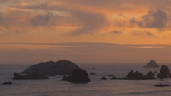 Rainbow Rock sunset, Southern Oregon coast (zoom out) Stock Footage