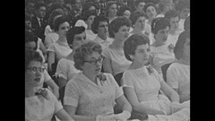 Vintage 16mm film, 1957 grad ceremony, audience, students on stage Stock Footage