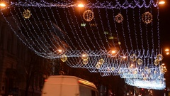Long Christmas garland above the carriageway in the city Stock Footage