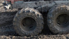 Offroad vehicle is trying to cross the muddy area Stock Footage