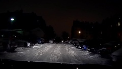 Night driving among cars, parking Stock Footage
