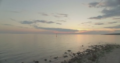 Aerial landscape 4k shot with drone above sea at sunset Stock Footage