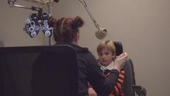 Little Boy Getting Eye Exam In Doctor's Office Stock Footage