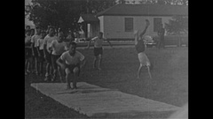 Vintage 16mm film, 1957 fitness Calisthenics, tumbling exercises, human pyramid Stock Footage