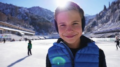 Close-up smiley boy face. Ice skating at ice rink outdoor Stock Footage