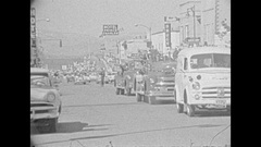 Vintage 16mm film, 1959 parade down main street, Vernon BC Stock Footage