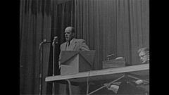 Vintage 16mm film, 1959 bald man speaking at mic, politics Stock Footage