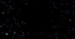 Electric blue sparkle background with particles flowing on black Stock Footage
