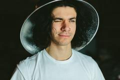Portrait of a young man in  strange unusual hat Stock Photos