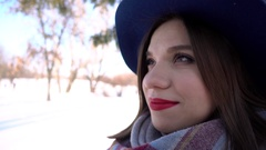 Lovely girl brunette with red lipstick on the lips gently smiling - Winter Park Stock Footage