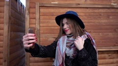 Young Woman taking selfie photo with Mobile Cell Phone iphone - winter day close Stock Footage
