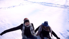 Young man and woman love, having fun in the winter day park falling on snow Stock Footage