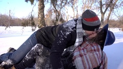Young man and woman Love Kiss, having fun in the winter day park falling on snow Stock Footage