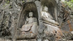 Buddhist carved stone statues of buddha in a cave at Lingyin Temple, China Stock Footage
