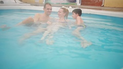 Hot Springs geothermal spa. family with children to relax in the hot pool. Stock Footage