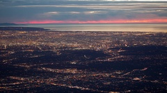 Time lapse high angle view of Los Angeles lights and the Pacific coast at sunset Stock Footage