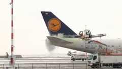De-icing of a Lufthansa Boeing 747 Stock Footage