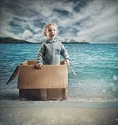Child adventure in the sea Stock Photos