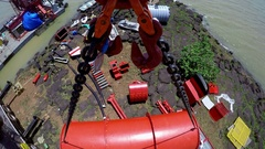 The camera is attached to a hook of a crane that moves a large red tanker. Stock Footage