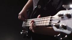 Man strums and plays electric guitar. Chord on guitar. Closeup Stock Footage