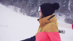 Young sporty woman in ski glasses smiling and waving with her hand calling Stock Footage