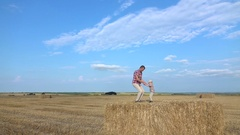 Jumping with son on the hay Stock Footage