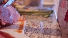 Dolly shot as woman cuts up a holiday ham for dinner Stock Footage
