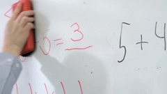 Pupil erases equation mathematics from board Stock Footage