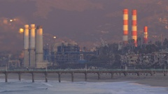 The sun rises on a power generating station, time-lapse. Stock Footage